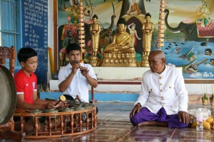 Seng Norn (right) with students of kantaoming, a Cambodian funeral music genre. Photo: Ian Kirkland, June 2014.